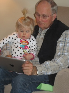 Looking at pictures with Grandpa