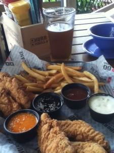 My awesome lunch of tenders with assorted dipping sauces, fries, and a beer (or two)!