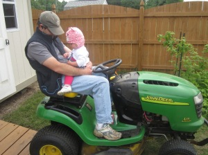 Helping Daddy get the John Deere going