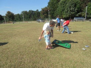 Teaching LB the finer aspects of corn hole