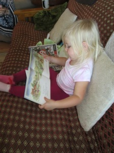 Reading to herself